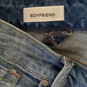 Only worn once blue faded jeans.